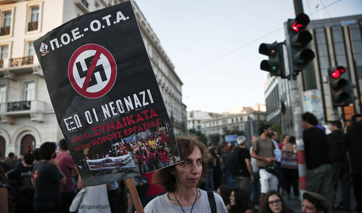A protester holds a banner during an anti-fascist rally in Athens