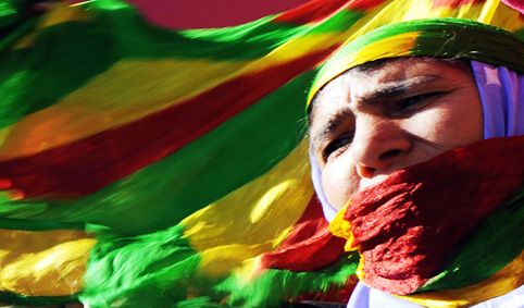 A Kurdish woman attends a gathering to c